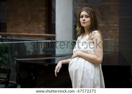 Portrait of a pregnant woman - stock photo