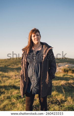 Portrait of a pregnant woman outdoors in a sunny day