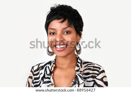 Portrait of a pretty black woman with a lovely smile - stock photo