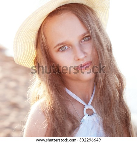 Portrait of a pretty blond girl  in a hat - stock photo