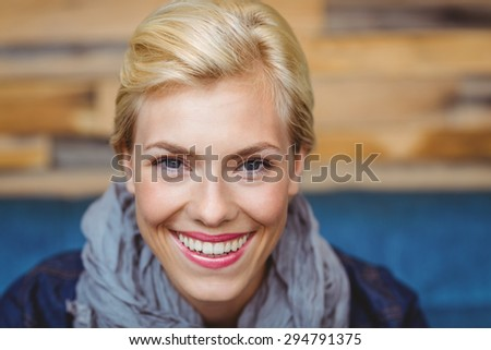 Portrait of a pretty blonde smiling at the camera