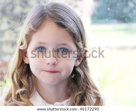 portrait of a pretty caucasaian girl with blue eyes - stock photo