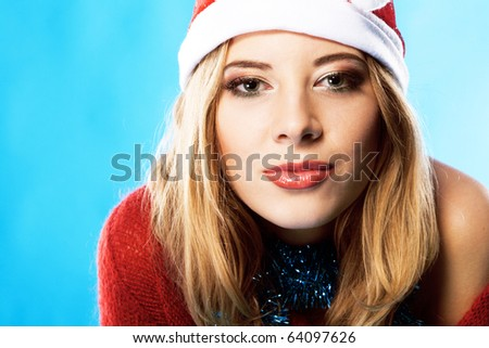 Portrait of a pretty Christmas girl against blue background - stock photo