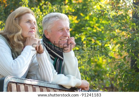 portrait of a pretty elderly couple at nature - stock photo