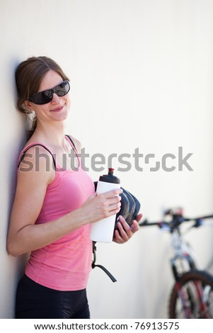 portrait of a pretty female biker - stock photo