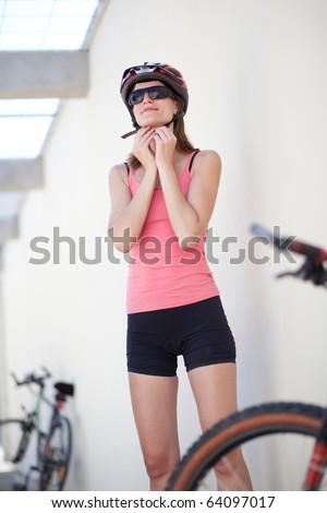 portrait of a pretty female biker (shallow DOF; color toned image) - stock photo