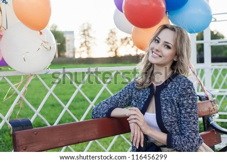 Portrait of a pretty girl in a park against the sunset, outdoors - stock photo