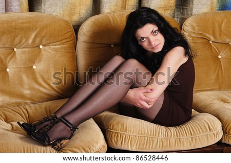 portrait of a pretty girl posing at sofa