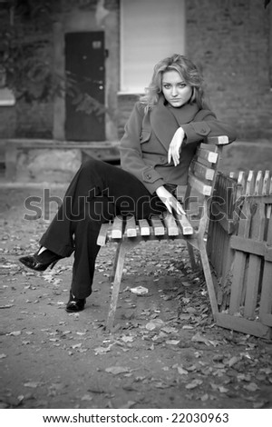 Portrait of a pretty girl sitting on a bench