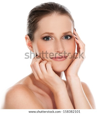 Portrait of a pretty girl with beautiful hands and face over a white background