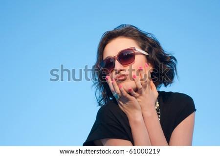 Portrait of a pretty girl with sun glasses - stock photo