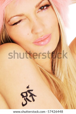 Portrait of a pretty girl with tattoo on her shoulder - stock photo