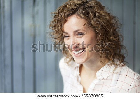 Portrait Of A Pretty Happy Woman - stock photo