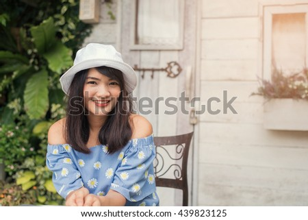 Portrait of a pretty happy woman, smiling - stock photo