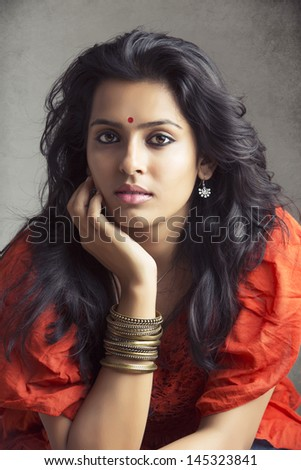 portrait of a pretty Indian young girl looking at the camera. - stock photo