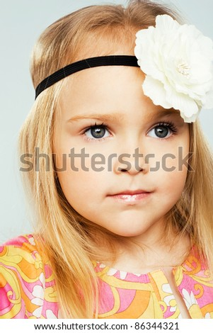 Portrait of a pretty little girl - stock photo