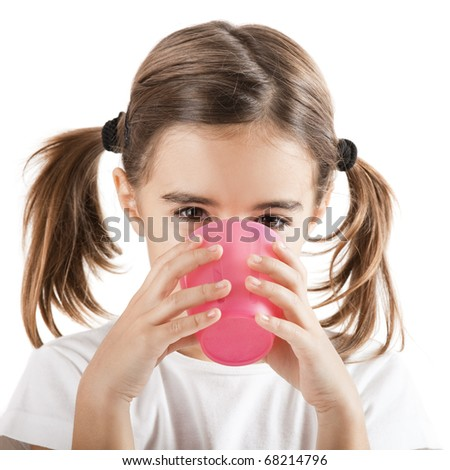 Portrait of a pretty little girl drinking water with a plastic cup, isolated on white background - stock photo