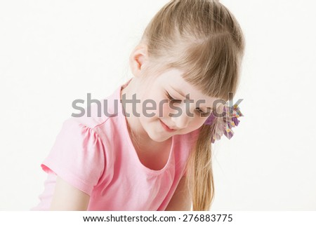 Portrait of a pretty little girl on white background - stock photo
