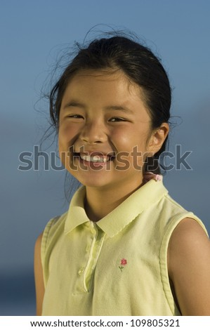 Portrait of a pretty little girl smiling - stock photo