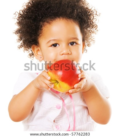 Portrait of a pretty little girl with a red apple on white background - stock photo