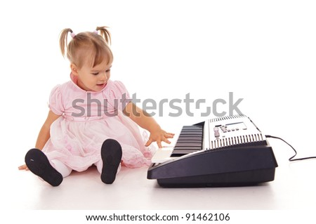 portrait of a pretty little girl with piano