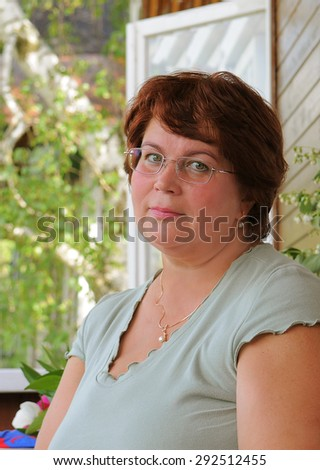 Portrait of a pretty middle-aged woman - stock photo