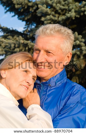 portrait of a pretty old couple at nature