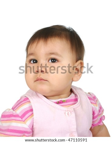 Portrait of a pretty one-year-old girl in pink outfit - stock photo