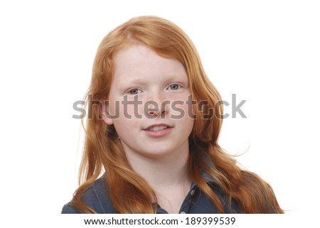 Portrait of a pretty red haired girl on white background