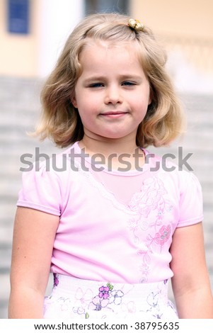 Portrait of a pretty small girl standing outdoor