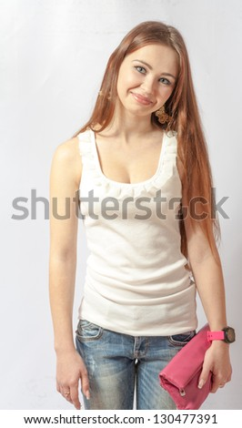 Portrait of a pretty, smiling blonde in jeans on white. 20-24 years old young women in studio front view - stock photo