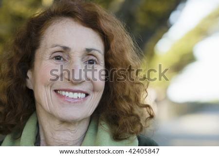 Portrait of a Pretty Smiling Senior Woman - stock photo