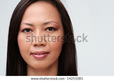 Portrait of a pretty woman from Thailand. - stock photo