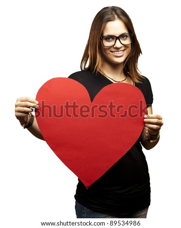 portrait of a pretty woman holding a paper heart against a white background - stock photo