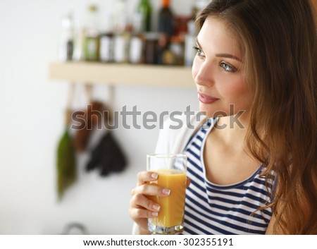 Portrait of a pretty woman holding glass with tasty juice . - stock photo
