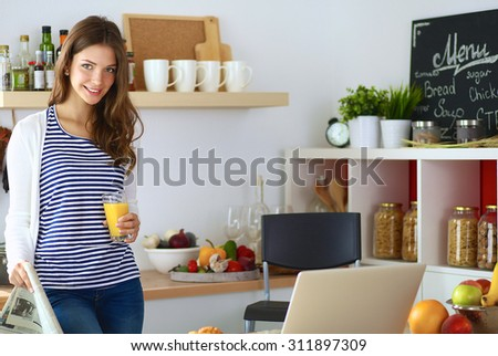 Portrait of a pretty woman holding glass with tasty juice - stock photo
