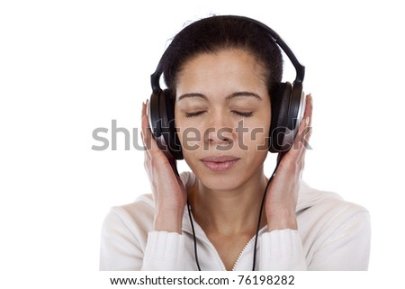 Portrait of a pretty woman listening music happily. Isolated on white background. - stock photo