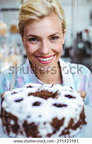Portrait of a pretty woman looking at a chocolate cake - stock photo