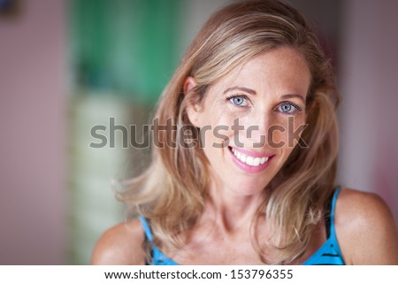 Portrait Of A Pretty Woman Looking At Camera - stock photo
