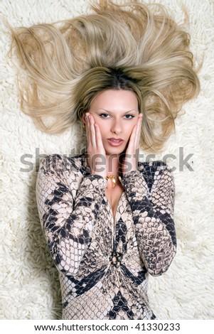 Portrait of a pretty woman on the carpet - stock photo