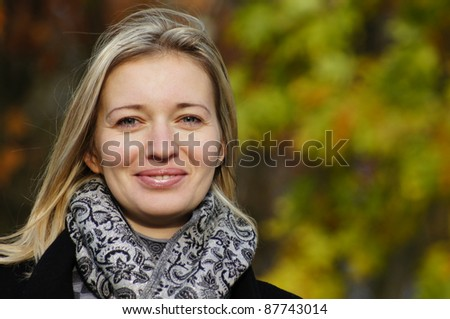 portrait of a pretty woman posing at nature - stock photo