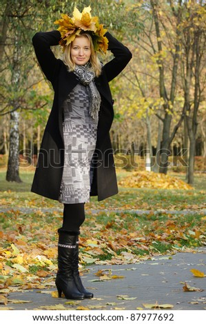portrait of a pretty woman posing at park - stock photo