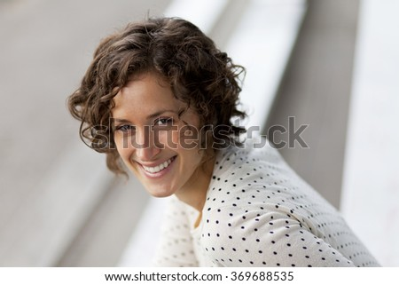 Portrait Of A Pretty woman smiling At the camera - stock photo