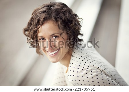 Portrait Of A Pretty Woman Smiling At The Park - stock photo