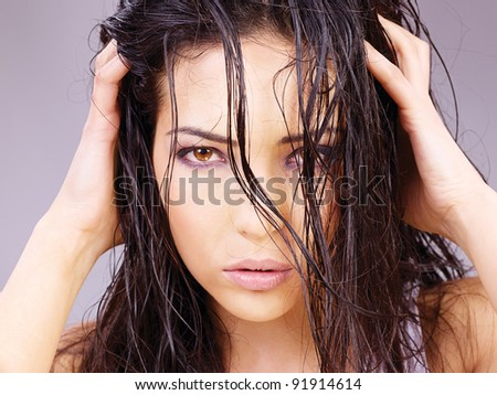 Portrait of a pretty woman with wet hair - stock photo