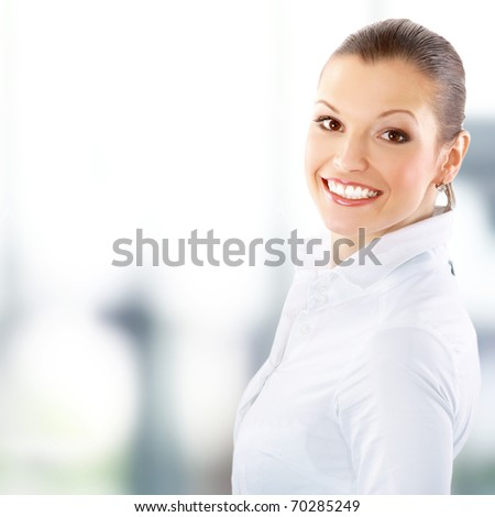 portrait of a pretty young business woman standing in office