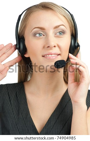 Portrait of a pretty young female call center employee wearing a headset, against white background