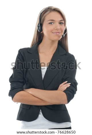 Portrait of a pretty young female call center employee with crossed arms wearing a headset, against white background