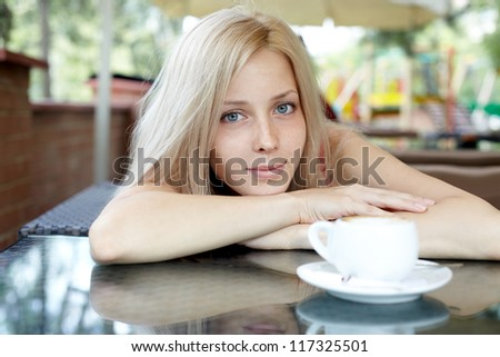 portrait of a pretty young female having a cup of coffee