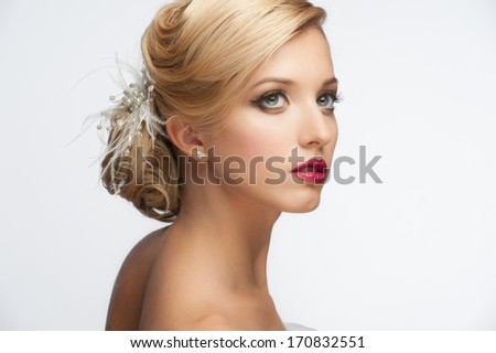 Portrait of a pretty young girl with a beautiful vintage hairstyle and makeup, wedding style - stock photo